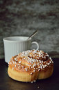 Have a coffee and cinnamon bun moment single cup spoon dark gray background Royalty Free Stock Image