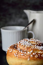 Have a coffee and cinnamon bun moment single cup spoon jug dark gray background Stock Images