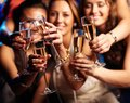 Have a drink group of partying girls clinking flutes with sparkling wine Royalty Free Stock Image