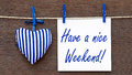 Have a nice weekend sign hung on washing line with decorative love heart Royalty Free Stock Image