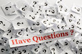 Have questions lot of question marks on white papers hard light Stock Photo