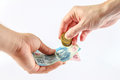 Have some cash person s hand giving money bills and coins to other Royalty Free Stock Photography