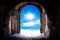 Haven s gate dark tunnel corridor with arch opening to the sun light at the end of the tunnel Royalty Free Stock Images
