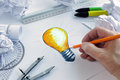 Having a bright idea designer drawing light bulb concept for brainstorming and inspiration Royalty Free Stock Image