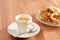 Having coffee and croissants in wooden table Royalty Free Stock Photography