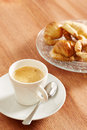 Having coffee and croissants in wooden table Royalty Free Stock Photo