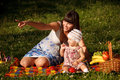 Having fun on picnic young women with her little year old daughter the in park Royalty Free Stock Images