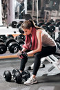 Having rest to drink athletic woman at gym Royalty Free Stock Photo