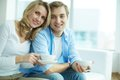 Having tea image of young guy and his girlfriend looking at camera while Stock Photography