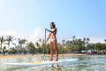 Hawaii beach lifestyle woman paddleboarding in bikini on sup beautiful multiethnic surfing on stand up paddleboard on big Stock Images