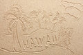 Hawaii handwritten from sand symbol tourism or conceptual designs Royalty Free Stock Images