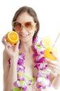 Hawaii woman in bikini wearing flower lei garland of pink orchid Royalty Free Stock Photo