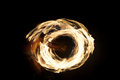 Hawaiian fire dance rings of formed during the performance Royalty Free Stock Photo