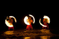 Hawaiian FIre Dancers in the Ocean Royalty Free Stock Photo