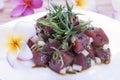 Hawaiian food poke seasoned raw tuna with plumeria flowers Royalty Free Stock Photography