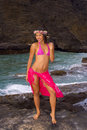 Hawaiian girl with flowers on lava Royalty Free Stock Image