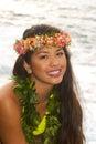 Hawaiian girl with flowers on lava