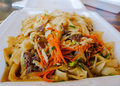 Hawaiian local food noodle plate lunch a favorite in hawaii known as here is chow fun noodles with teriyaki beef and vegetables Stock Image