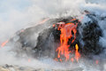 Hawaiian magma flowing into pacific ocean from a volcano the captured by boat Stock Photography