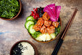 Hawaiian salmon poke bowl with seaweed, watermelon radish, cucumber, pineapple and sesame seeds. Copy space Royalty Free Stock Photo