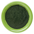 Hawaiian spirulina powder small bowl of isolated on white Royalty Free Stock Images