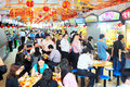 Hawker center in singapore republic of march locals eat at a popular food hall inexpensive food stalls are numerous the Royalty Free Stock Photography