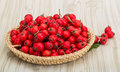 Hawthorn berries in the bowl on wood background Royalty Free Stock Photos