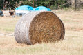 Hay bale with arrows round compoud bow in it Stock Photo