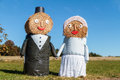 Hay bale bridal couple marriage tradition in bavaria lovely puppets made out of with suit and wedding dress in europe in autumn Royalty Free Stock Image