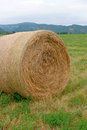 Hay bale single with hills in the distance Royalty Free Stock Images