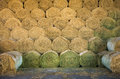 Hay bales rolled stacked in storage Stock Photo