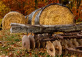 Hay bales and tiller with vintage equipment resting after fall harvest Royalty Free Stock Photography