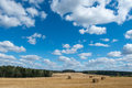 Hay field clouds Royalty Free Stock Photo