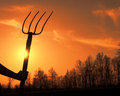Hay fork woman holding at sunset Royalty Free Stock Images