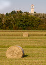 Hay rolls and belfry vertical view Royalty Free Stock Images