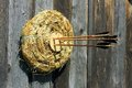 Hay target with bow arrows in it on the wood wall background Royalty Free Stock Images