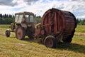 Haymaking time round baling hay and farming tractor in farmland lemozero olonets karelia russia july harvest russian north Stock Photo