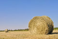 Haystack a in a field under blue sky Stock Photo