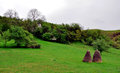 Haystack in nature mountain landscape with and green grass Stock Photography