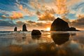 Haystack rock at sunset cannon beach oregon Stock Photos