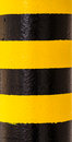 Hazard warning on pillar yellow and black stripes painted a column Stock Image