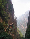 Hazardous pathway over the precipice in huang shan china july made on vertical slope of a mountain yellow mountains on july Stock Images