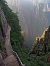 Hazardous pathway over the precipice in huang shan china spectacular made on vertical slope of a mountain yellow mountains Stock Photos