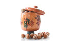 Hazelnut brown in wooden pot over white background Royalty Free Stock Images