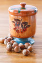 Hazelnut brown in wooden pot the on a table Royalty Free Stock Photo
