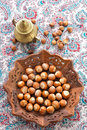 Hazelnut indian wooden plate Stock Photos