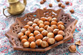 Hazelnut indian wooden plate Stock Image
