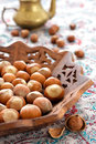 Hazelnut indian wooden plate Royalty Free Stock Photos