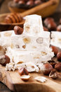 Hazelnut nougat or torrone delicious italian festive with hazelnuts on a wood Stock Image