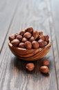 Hazelnut in a wooden bowl closeup on background Stock Photos